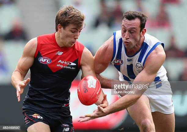 Jack Viney of the Demons and Todd Goldstein of the Kangaroos compete for the ball during the round 19 AFL match between the Melbourne Demons and the...