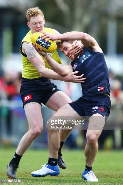 Jack Viney of the Demons back in full training for the first time since injury is tackled by Clayton Oliver of the Demons during a Melbourne Demons...