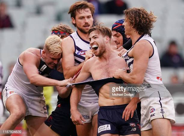 Jack Viney of the Demons gets his jumper ripped whilst in a melee during the round 14 AFL match between the Melbourne Demons and the Fremantle...