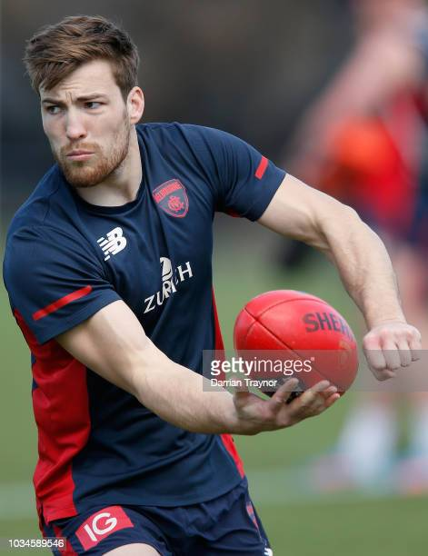 Jack Viney of the Demons handballs during a Melbourne Demons AFL training session at Gosch's Paddock on September 17 2018 in Melbourne Australia