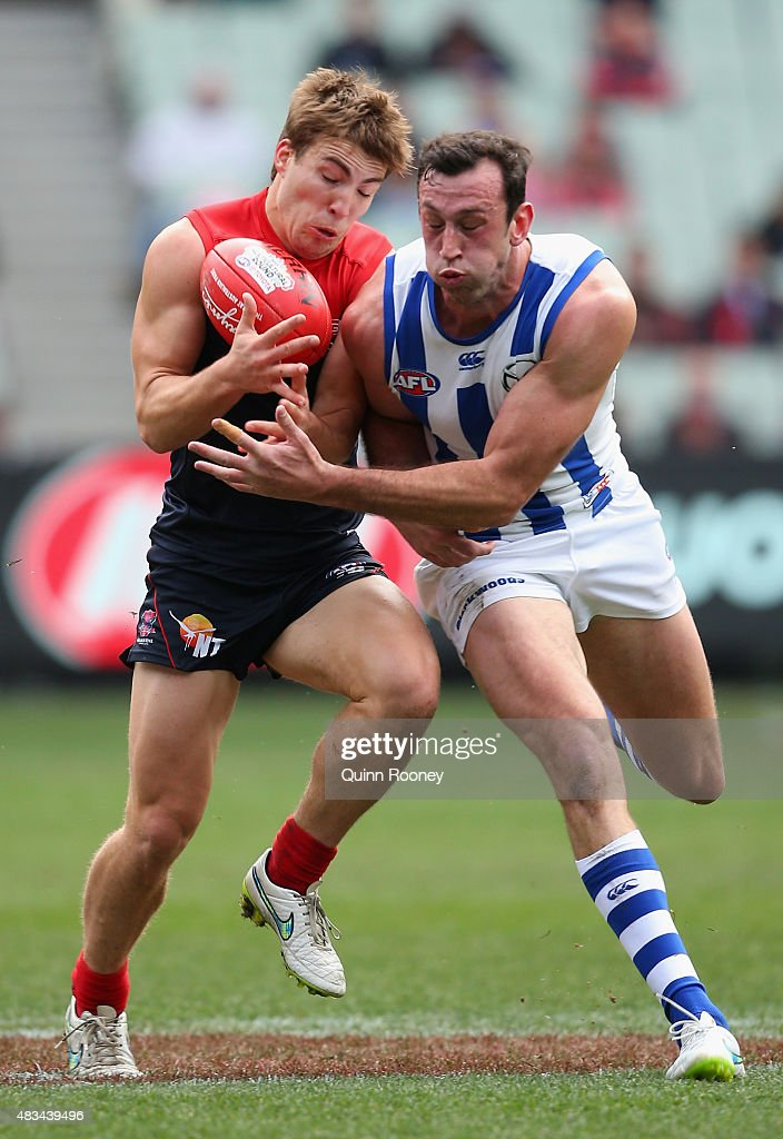 Jack Viney of the Demons is bumped by Todd Goldstein of the Kangaroos during the round 19 AFL match between the Melbourne Demons and the North Melbourne Kangaroos at Melbourne Cricket Ground on August 9, 2015 in Melbourne, Australia.