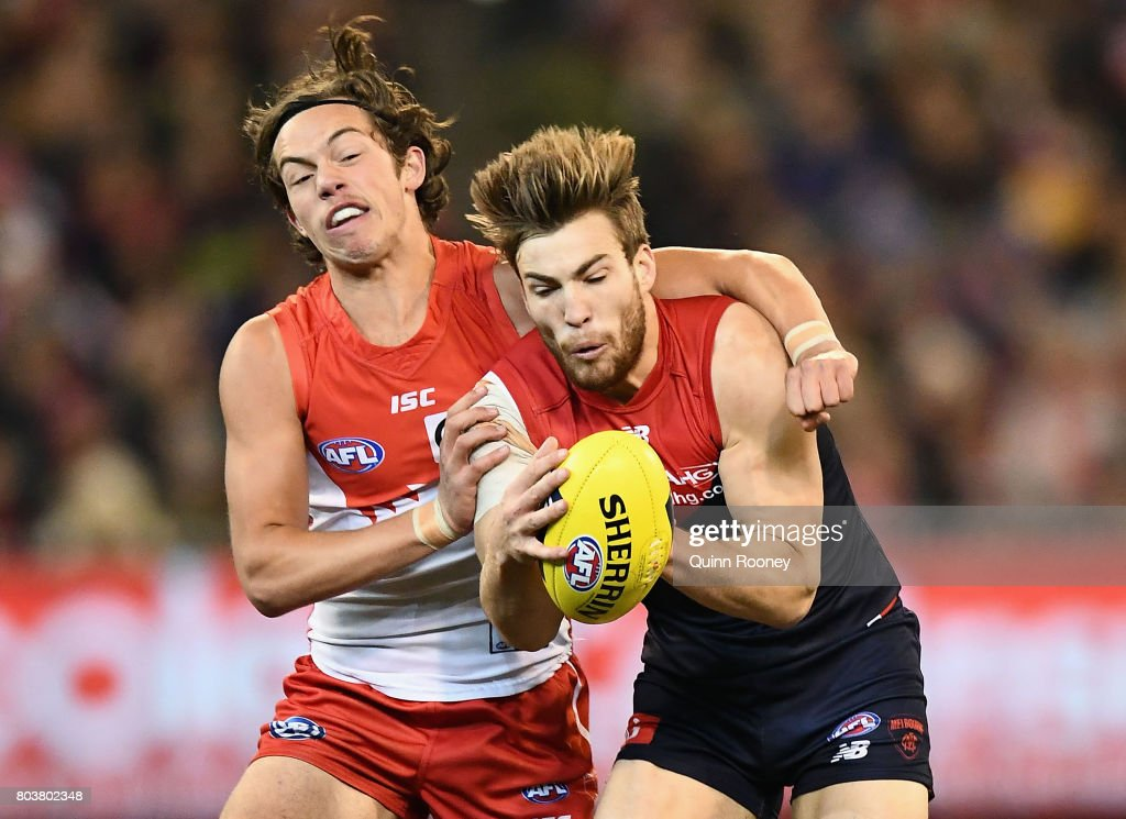 Jack Viney of the Demons marks infront of Oliver Florent of the Swans during the round 15 AFL match between the Melbourne Demons and the Sydney Swans at Melbourne Cricket Ground on June 30, 2017 in Melbourne, Australia.
