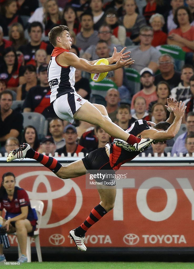 Jack Viney of the Demons marks the ball over Brent Stanton of the Bombers during the round two AFL match between the Essendon Bombers and the Melbourne Demons at Melbourne Cricket Ground on April 6, 2013 in Melbourne, Australia.