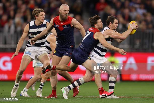 Jack Viney of the Demons tackles Patrick Dangerfield of the Cats during the AFL First Preliminary Final match between the Melbourne Demons and...