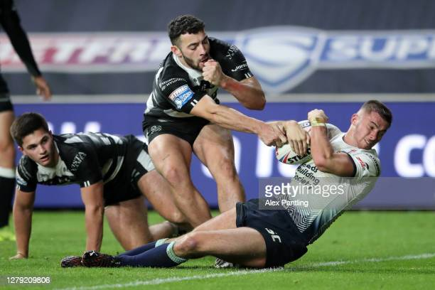 Jack Walker of Leeds Rhinos scores his sides first try during the Betfred Super League match between Hull FC and Leeds Rhinos at Emerald Headingley...