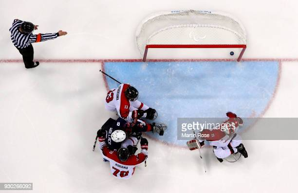 Jack Wallace of United States scores a goal in the Ice Hockey Preliminary Round Group B game between United States and Japan during day two of the...