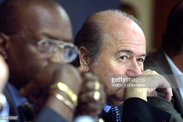Jack Warner president of the Confederation of Football and Joseph Blatter president of the Federation Internationale de Football participate in a...