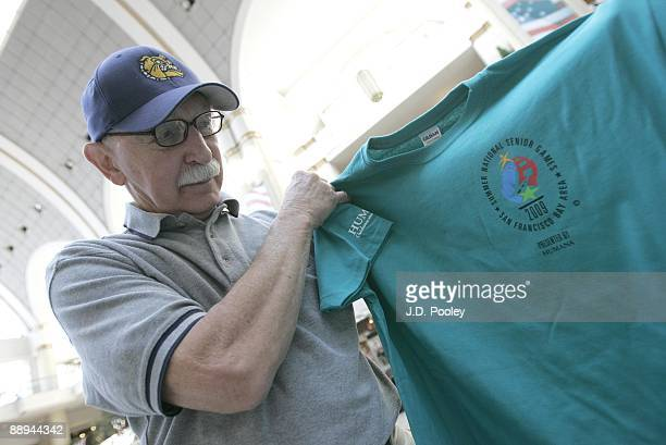 Jack Warning who competes in basketball, looks over a t-shirt while attending the 2009 Humana & National Senior Games Athlete send-off tour at Tower...