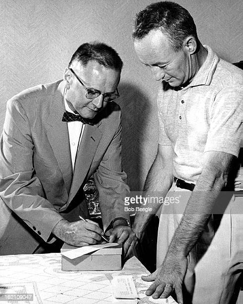 BALLOTING Jack Watson of 1119 S Gilpin St casts his ballot at Precinct 3033's Republican caucus At right is Robert E Lee Republican county chairman...