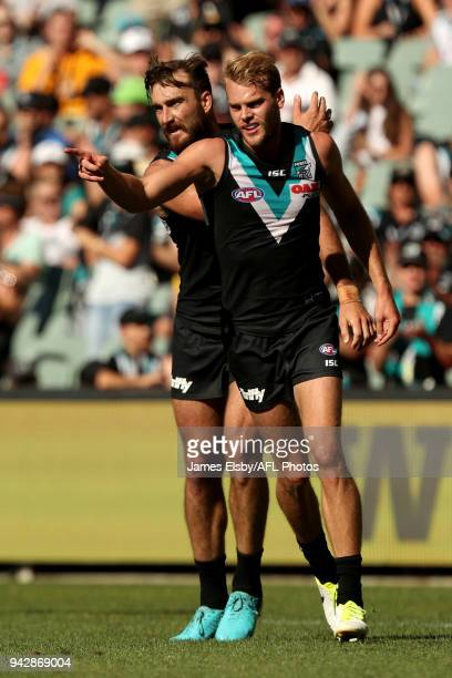 Jack Watts and Charlie Dixon of the Power celebrate a goal during the 2018 AFL round 03 match between the Port Adelaide Power and the Brisbane Lions...