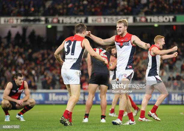 Jack Watts celebrates with Jack Grimes of the Demons at the final siren after winning the round 13 AFL match between the Essendon Bombers and the...