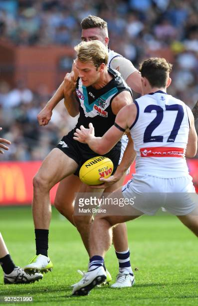 Jack Watts of Port Adelaide and Lachie Neale of the Dockers during the round one AFL match between the Port Adelaide Power and the Fremantle Dockers...