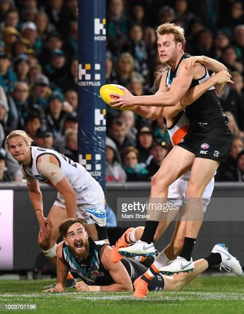 Jack Watts of Port Adelaide gets caught in the goal square watched by Charlie Dixon of Port Adelaide during the round 18 AFL match between the Port...