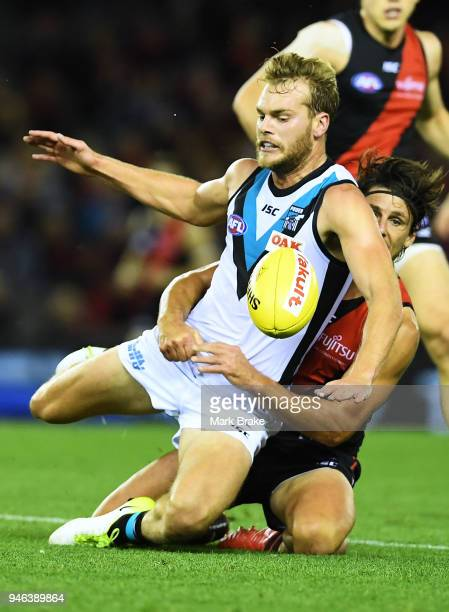 Jack Watts of Port Adelaide gets tackled by Mark Baguley of the Bombers during the round four AFL match between the Essendon Bombers and the Port...