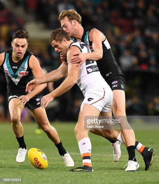 Jack Watts of Port Adelaide Phil Davis of the Giants during the round 18 AFL match between the Port Adelaide Power and the Greater Western Sydney...