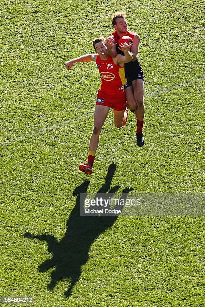 Jack Watts of the Demons competes for the ball against Tom Lynch of the Suns during the round 19 AFL match between the Melbourne Demons and the Gold...