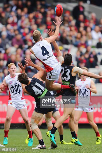 Jack Watts of the Demons competes for the ball during the round 22 AFL match between the Carlton Blues and the Melbourne Demons at Melbourne Cricket...