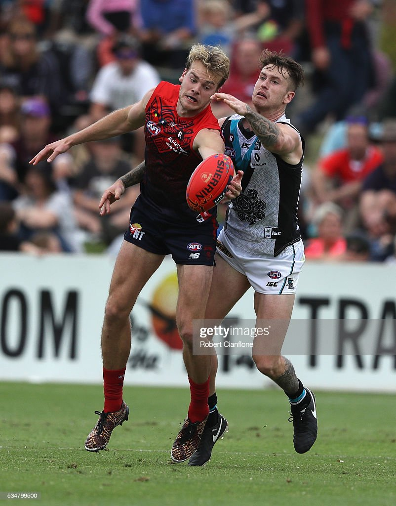 Jack Watts of the Demons is challenged by Cam O'Shea of Port Adelaide during the round 10 AFL match between the Melbourne Demons and the Port Adelaide Power at Traeger Park on May 28, 2016 in Alice Springs, Australia.