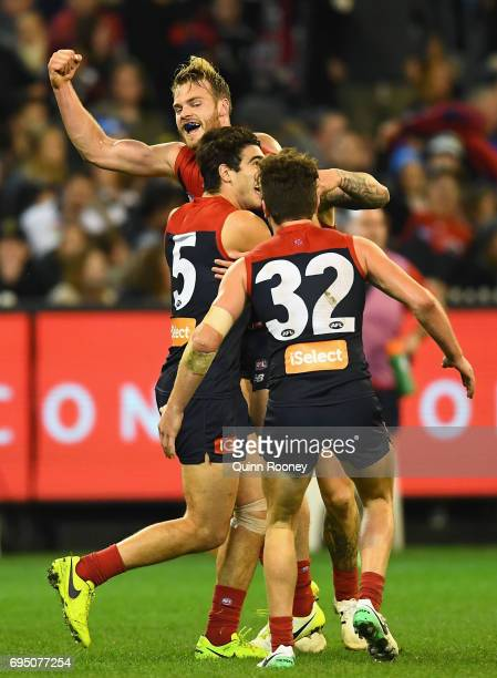 Jack Watts of the Demons is congratulated by team mates after kicking a goal during the round 12 AFL match between the Melbourne Demons and the...