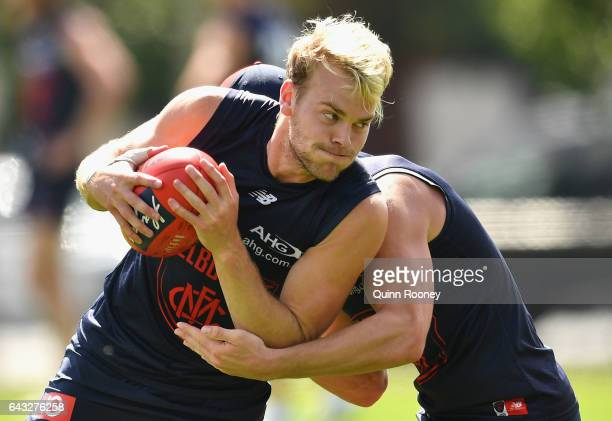 Jack Watts of the Demons is tackled by Angus Brayshaw of the Demons during a Melbourne Demons AFL training session on February 21 2017 in Melbourne...