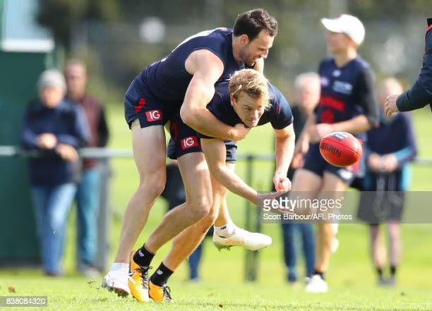 Jack Watts of the Demons is tackled by Cameron Pedersen of the Demons during a Melbourne Demons AFL training session at Gosch's Paddock on August 24...