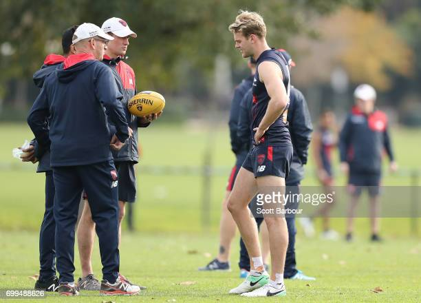 Jack Watts of the Demons speaks to coaching staff as he leaves training early after appearing to injure his hamstring during a Melbourne Demons AFL...