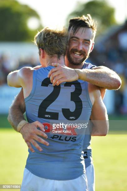 Jack Watts of the Power and Charlie Dixon of the Power celebrate after the JLT Community Series AFL match between Port Adelaide Power and the...