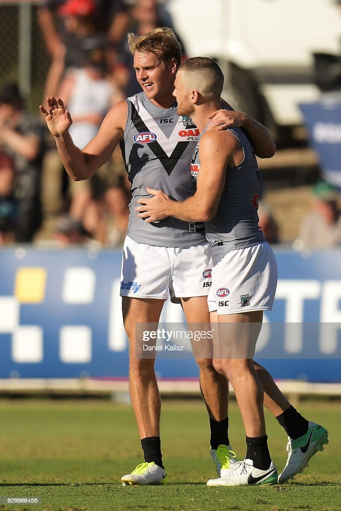 Jack Watts of the Power celebrates with Robbie Gray of the Power during the JLT Community Series AFL match between Port Adelaide Power and the Adelaide Crows at Alberton Oval on March 10, 2018 in Adelaide, Australia.