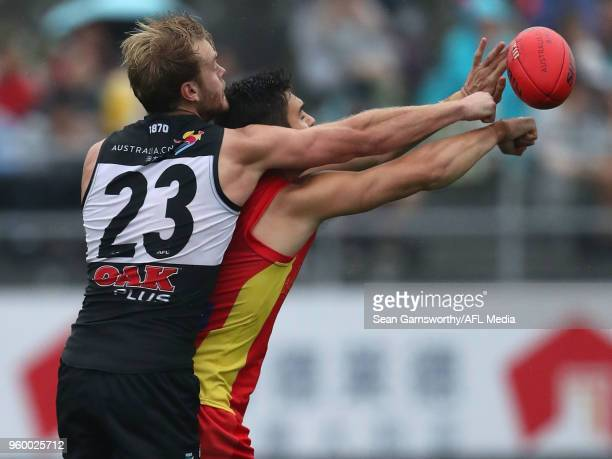 Jack Watts of the Power spoils during the 2018 AFL round nine match between the Gold Coast Suns and the Port Adelaide Power at Adelaide Arena at...