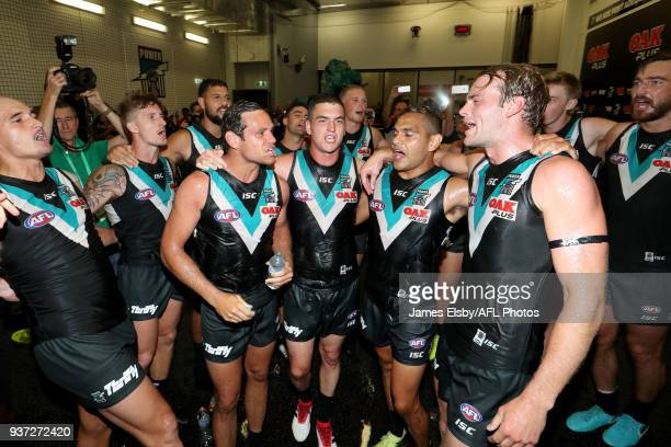 Jack Watts Steven Motlop Tom Rockliff and Dom Barry of the Power celebrate their win during the 2018 AFL round 01 match between the Port Adelaide...