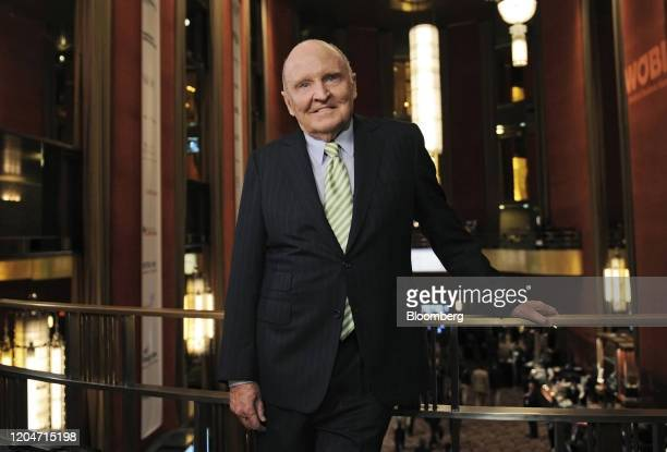 Jack Welch, former chairman and chief executive officer of General Electric Co., stands for a photograph at the World Business Forum in New York,...