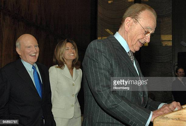 Jack Welch left former chief executive of General Electric Co and author of the book Winning laughs with his wife Suzy at a joke made by News Corp...