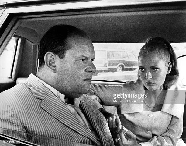Jack Weston sits in a car with Faye Dunaway in a scene from the movie The Thomas Crown Affair circa 1968