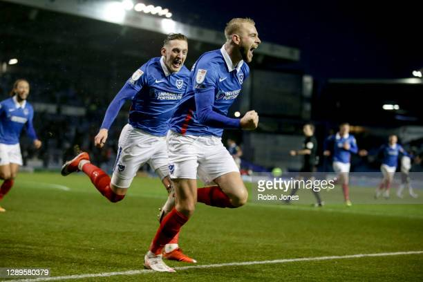 Jack Whatmough of Portsmouth FC celebrates with team-mate Ronan Curtis after he heads in and scores a goal to make it 1-0 during the Sky Bet League...