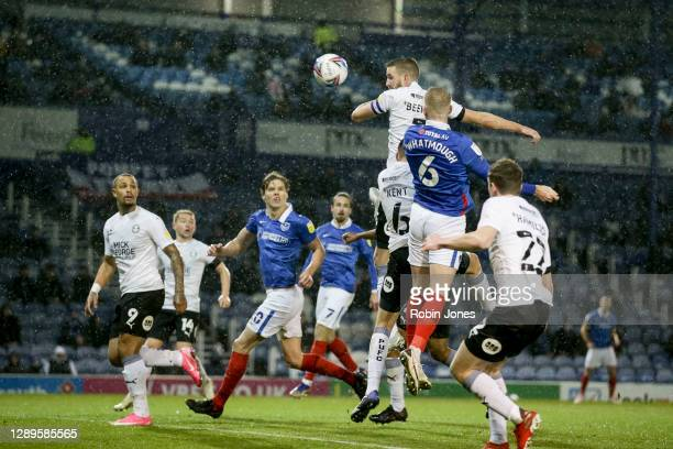 Jack Whatmough of Portsmouth FC heads in and scores a goal to make it 1-0 during the Sky Bet League One match between Portsmouth and Peterborough...