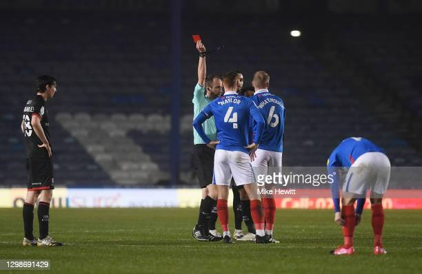 Jack Whatmough of Portsmouth FC is shown a red card by referee Sam Purkiss during the Sky Bet League One match between Portsmouth and Lincoln City at...
