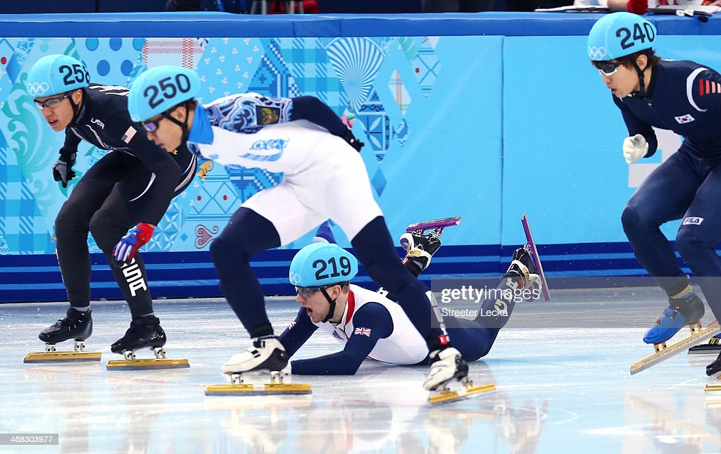 Jack Whelbourne of Great Britain falls as J.R. Celski of the United States, Victor An of Russia and Han-Bin Lee of South Korea in the Short Track Men's 1500m Final on day 3 of the Sochi 2014 Winter Olympics at Iceberg Skating Palace on February 10, 2014 in Sochi, Russia.
