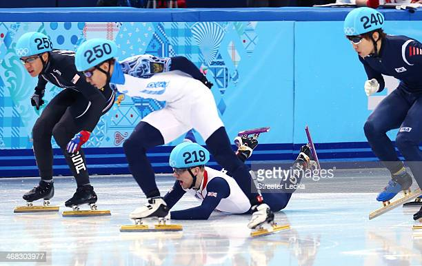 Jack Whelbourne of Great Britain falls as JR Celski of the United States Victor An of Russia and HanBin Lee of South Korea in the Short Track Men's...