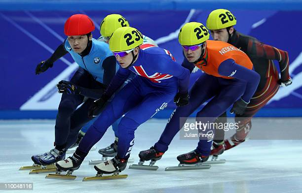 Jack Whelbourne of Great Britain leads Simon Cho of USA and Sjinkie Knegt of Netherlands in the 1000m heats during day three of the ISU World Short...