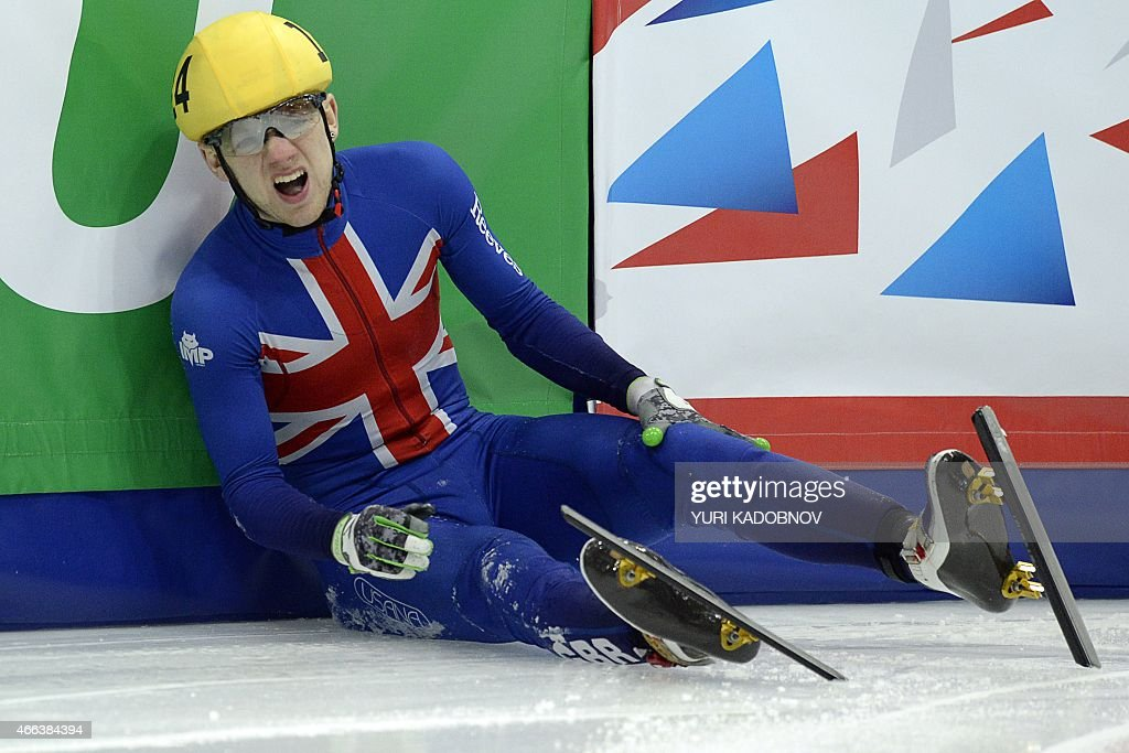 Jack Whelbourne of Great Britain reacts after falling in the men's 1000m quarter final race of the ISU World Short Track Speed Skating Championships in Moscow on March 15, 2015.