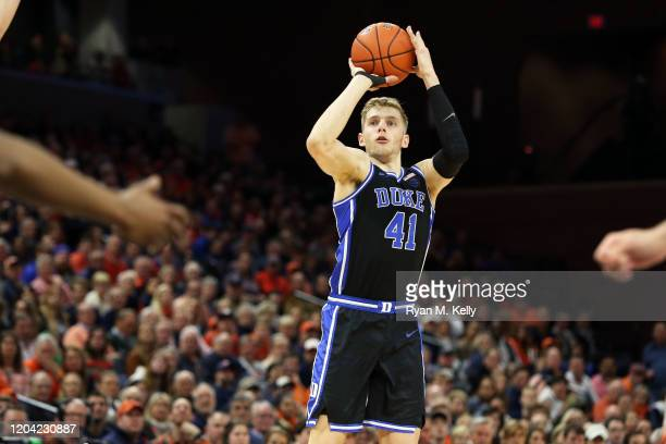 Jack White of the Duke Blue Devils shoots in the first half during a game against the Virginia Cavaliers at John Paul Jones Arena on February 29,...