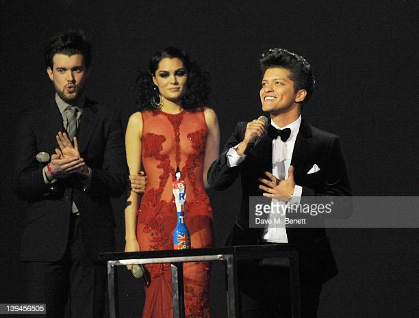 Jack Whitehall and Jessie J present Bruno Mars with the Best International Male award during the BRIT Awards 2012 held at the O2 Arena on February...