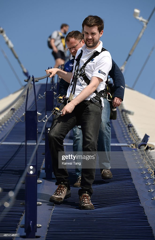 Jack Whitehall scales the 02 Arena during a photocall to launch the Virgin STRIVE Challenge held at the 02 Arena on April 30, 2014 in London, England.