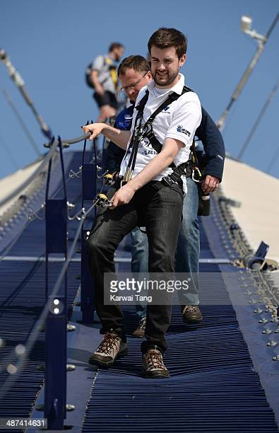 Jack Whitehall scales the 02 Arena during a photocall to launch the Virgin STRIVE Challenge held at the 02 Arena on April 30 2014 in London England