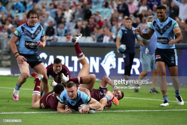 Jack Wighton of the Blues celebrates after scoring a try during game two of the 2020 State of Origin series between the New South Wales Blues and the...