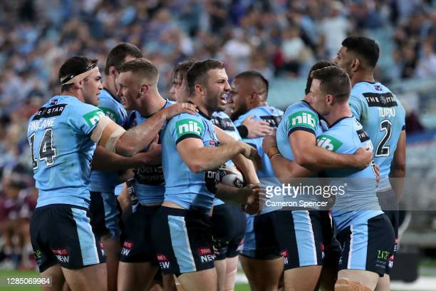 Jack Wighton of the Blues celebrates after scoring a try with James Tedesco and his team during game two of the 2020 State of Origin series between...