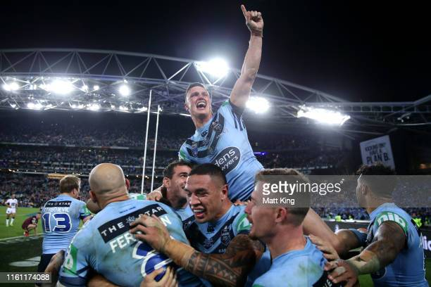 Jack Wighton of the Blues celebrates with team mates after winning game three of the 2019 State of Origin series between the New South Wales Blues...