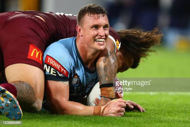 Jack Wighton of the Blues scores a try during game three of the 2021 State of Origin Series between the New South Wales Blues and the Queensland...
