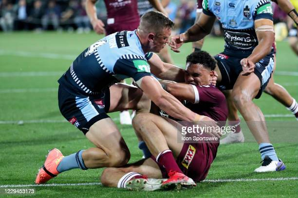 Jack Wighton of the NSW Blues tackles Xavier Coates of the QLD Maroons during game one of the 2020 State of Origin series between the Queensland...