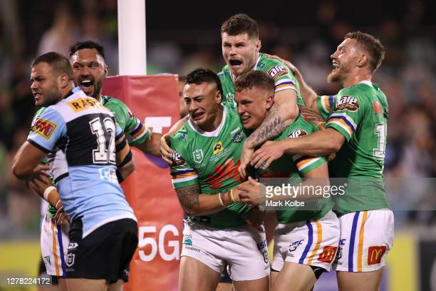 Jack Wighton of the Raiders celebrates after scoring a try as Wade Graham of the Sharks gestures to the referee during the NRL Elimination Final...